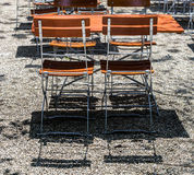 Wooden chairs and tables in park cafe Stock Photography