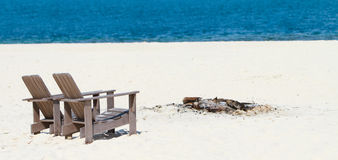 Wooden chairs at tropical beach panorama Royalty Free Stock Photos