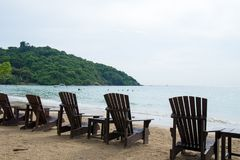 Wooden chairs for vacations and relax at the beach.  Royalty Free Stock Photography