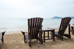Wooden chairs for vacations and relax at the beach.  Stock Image