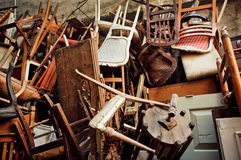 Wooden chairs and vintage chairs, thrown into the street Stock Photo