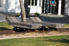 Wooden chaise longue on rail tracks. Solid wooden chaise longue on rail tracks stock photo