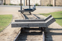 Wooden chaise longue on rail tracks. Solid wooden chaise longue on rail tracks stock image