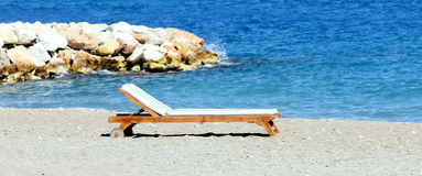 Wooden chaise lounge Stock Photo