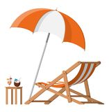 Wooden chaise lounge, umbrella, cocktail. Wooden chaise lounge. Sun lounger, deckchair, sunbed, beach chair with umbrella. Table with glass of cocktail and Stock Photos