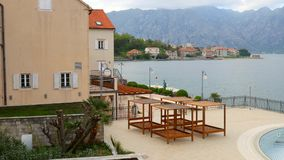 Wooden chaise lounges by the sea. Hotel in Kotor Bay in Monteneg. Ro stock footage