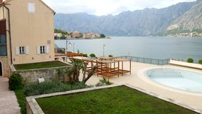 Wooden chaise lounges by the sea. Hotel in Kotor bay in Monteneg. Ro stock video