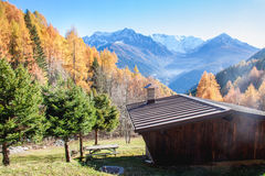 Wooden chalet in a colourful Autumnal panorama In Italy Royalty Free Stock Photography