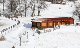 Wooden chalet in the mountains and snowy Royalty Free Stock Image