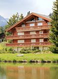 Wooden chalet in the mountaintrees Stock Photography