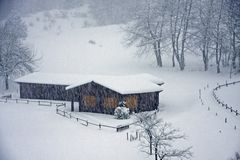 Wooden Chalet On The Italian Alps During A Heavy Snowfall Royalty Free Stock Photo