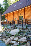 Wooden chalet on rocky valley stock images
