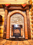 Wooden chalet with small fireplace Royalty Free Stock Image