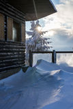 Wooden chalet in snowy freezing mountain Stock Photo