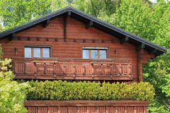 Wooden chalet among summer trees Stock Photography