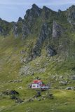 Wooden chalet under the summit . Royalty Free Stock Photo