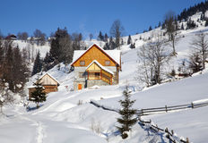 Wooden chalet in winter Carpathian mountains Stock Image