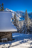 Wooden chalet in winter mountains Stock Image