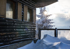 Wooden chalet in the winter nature Stock Images