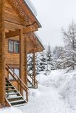 Wooden chalets in the ski resort Bukovel. Chalet in the ski resort. Wooden house in the resort Bukovel in Ukraine. Two-storey cottages of logs. Natural building stock images