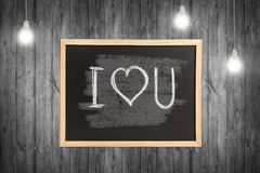 Wooden chalkboard with I love you note Royalty Free Stock Photography