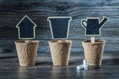 Wooden chalkboard price sign tags in peat pots stock photo