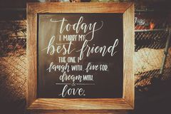 Wooden chalkboard wedding sign with poem royalty free stock photos