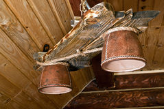 Wooden chandelier with 2 lamps Royalty Free Stock Images