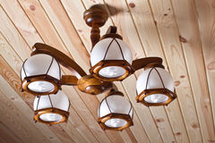 Wooden chandelier on the ceiling Royalty Free Stock Image