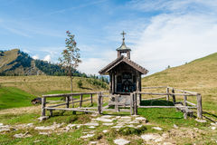 Wooden chapel in the alps Royalty Free Stock Photos