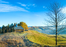 Wooden chapel on autumn mountain top Royalty Free Stock Photo
