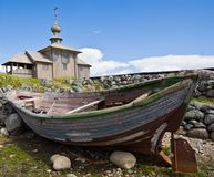 Wooden chapel and boat on Greater Zayatsky island Royalty Free Stock Photo