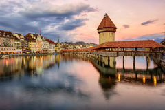 Wooden Chapel Bridge and Water Tower on sunset, Lucerne, Switzer Stock Image