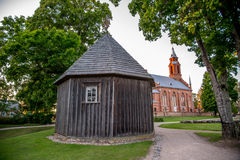 Wooden chapel and church on Kernave mound. Wooden chapel on Kernave mound, ancient Lithuanian place Royalty Free Stock Photos