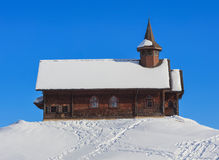 Wooden chapel covered by snow in the village of Stoos in Switzer. Wooden chapel covered by snow in the village of Stoos in the Swiss canton of Schwyz. Village of Royalty Free Stock Photo