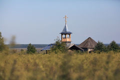 Wooden chapel. In the field Stock Photo