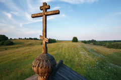 Wooden chapel in the field Stock Photography