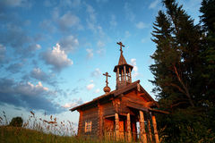 Wooden chapel in the field Stock Photo