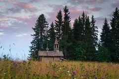 Wooden chapel in the field. Wooden chapel on the field in the north of Russia Stock Photo