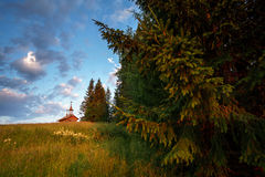 Wooden chapel in the field. Wooden chapel on the field in the north of Russia Royalty Free Stock Image
