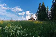 Wooden chapel in the field. Wooden chapel on the field in the north of Russia Royalty Free Stock Photos