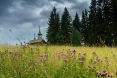 Wooden chapel in the field. Wooden chapel on the field in the north of Russia Royalty Free Stock Images