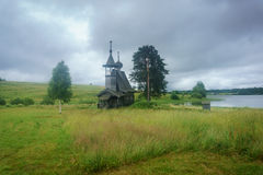 Wooden chapel in the field. Wooden chapel on the field in the north of Russia Royalty Free Stock Photography
