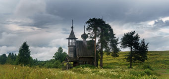 Wooden chapel in the field. Wooden chapel on the field in the north of Russia Stock Photos