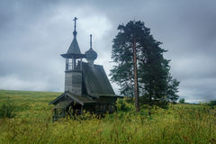 Wooden chapel in the field. Wooden chapel on the field in the north of Russia Royalty Free Stock Photo