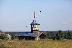 Wooden chapel in the field Stock Photos