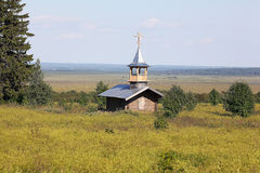 Wooden chapel in the field. Wooden chapel in the summer field Royalty Free Stock Photos