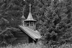The wooden chapel in the forest Stock Photography