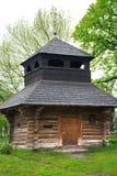 Wooden chapel near the church Stock Image