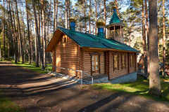Wooden chapel in pine forest in Chemal Stock Images